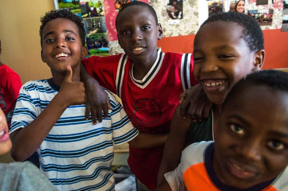 Chris Detrick  |  The Salt Lake Tribune Emaddin Ali, 10, Innocent Byiringiro, 11, Ishimwe Deuestbon, 10, and Obed Sadiki, 10, pose for a portrait at the Hser Ner Moo Community Center in South Salt Lake on Tuesday, July 18, 2017.