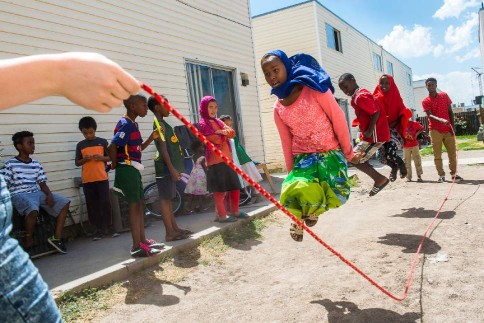Chris Detrick  |  The Salt Lake Tribune Sumeya Ahmed, 11, Innocent Byiringiro, 11, and Halima Abdinasir, 13, jump as Promise Prevention Specialists Rylee Black (not pictured) and Said Mohamed swing the rope at the Hser Ner Moo Community Center in South Salt Lake on Tuesday, July 18, 2017.