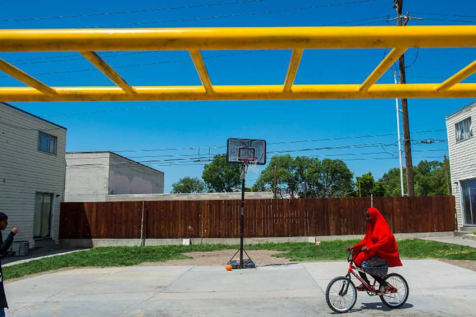 Chris Detrick  |  The Salt Lake Tribune Halima Abdinasir, 13, rides a bike around at the Hser Ner Moo Community Center in South Salt Lake on Tuesday, July 18, 2017.