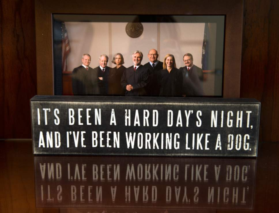 "Leah Hogsten  |  The Salt Lake Tribune Utah Court of Appeals Presiding Judge Frederic Voros' desk displays a photo of him and his colleagues, along with a quote from the Beatles' song ""Hard Days Night."" Voros is retiring August 1, 2017, from the bench."
