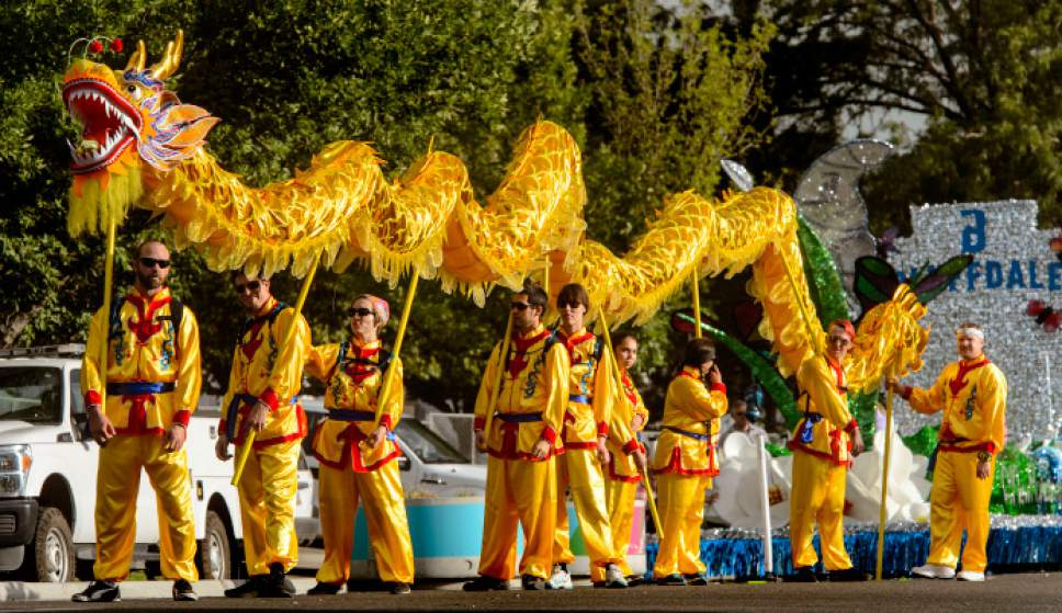 Steve Griffin     The Salt Lake Tribune   Members of the Chinese Society of Utah carry a dragon as the sun rises over the Wasatch Front prior to the start of the Days of '47 Parade in Salt Lake City on Monday, July 24, 2017.