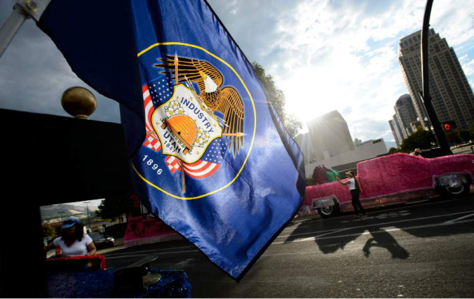 Steve Griffin     The Salt Lake Tribune   Utah's state flag waves in the morning sun at the start of the Days of '47 Parade in Salt Lake City on Monday, July 24, 2017.