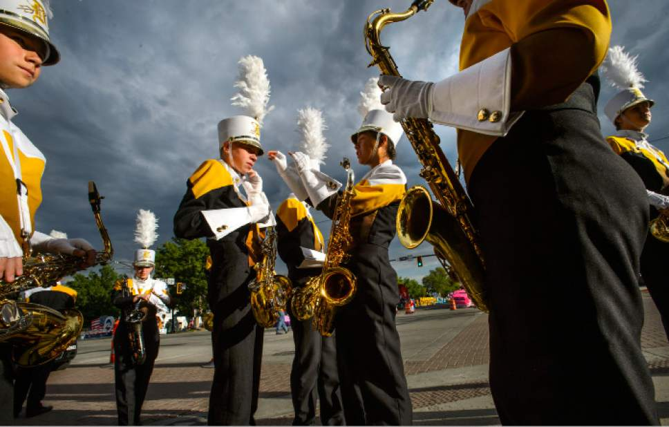 Steve Griffin     The Salt Lake Tribune   Members of the Davis High School marching band prepare at the start of the Days of '47 Parade in Salt Lake City on Monday, July 24, 2017.