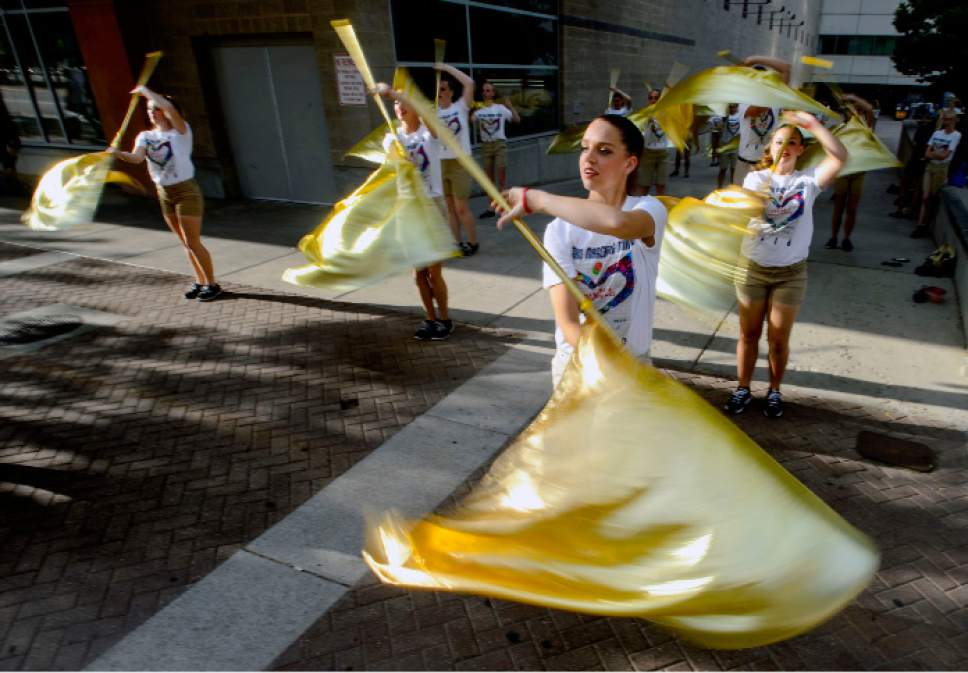 Steve Griffin     The Salt Lake Tribune   Members of the Westlake Marching Thunder warm-up prior to the start of the Days of '47 Parade in Salt Lake City on Monday, July 24, 2017.