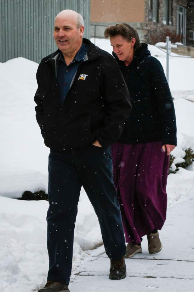 """FILE - This Feb. 3, 2017, file photo, Gail Blackmore, right, and James Oler arrive at the courthouse in Cranbrook, British Columbia. Two former bishops of an isolated religious commune in British Columbia were convicted Monday, July 24, of practicing polygamy after a decades-long legal fight launched by the provincial government. The court found James Oler married five women in so-called """"celestial"""" marriages involving residents in the tiny religious community of Bountiful. (Jeff McIntosh/The Canadian Press via AP, File)"""