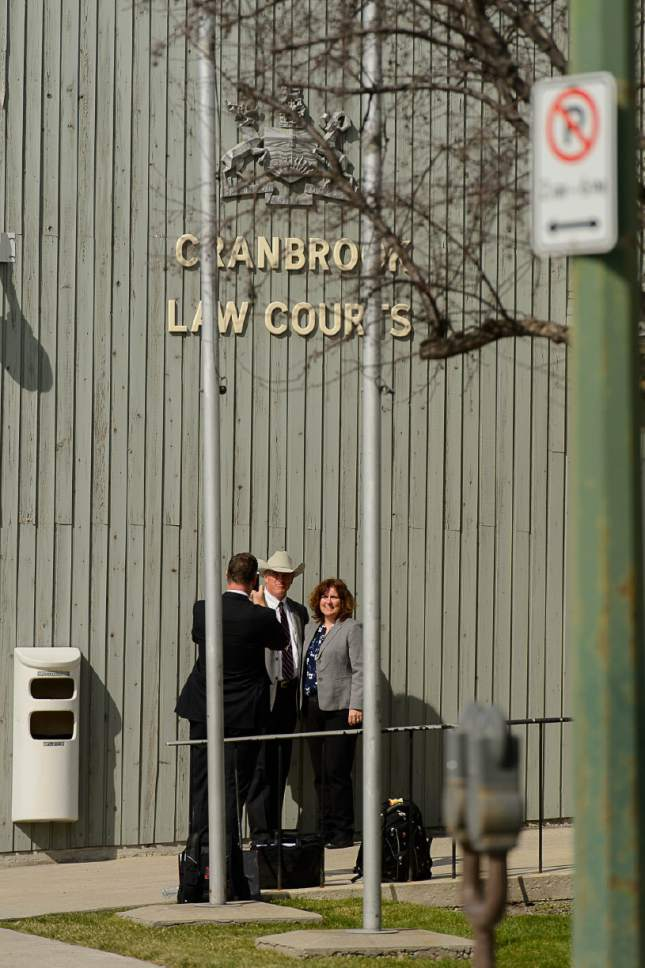 Trent Nelson  |  The Salt Lake Tribune Texas Ranger Nick Hanna poses for a souvenir photo with RCMP Constable Shelley Livingstone at the courthouse in Cranbrook, B.C., Wednesday April 19, 2017. Blackmore and co-defendant James Oler are the first fundamentalist Mormons to be tried for polygamy in Canada.