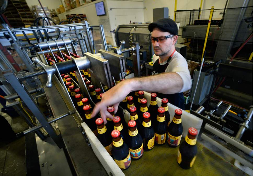 Scott Sommerdorf   |  The Salt Lake Tribune   Bottles of HooDoo Golden Ale travel down Uinta Brewing Co.'s packaging line, on Thursday, July 20, 2017. It's one of several beers -- 3.2 percent alcohol by weight -- produced for the Utah market..