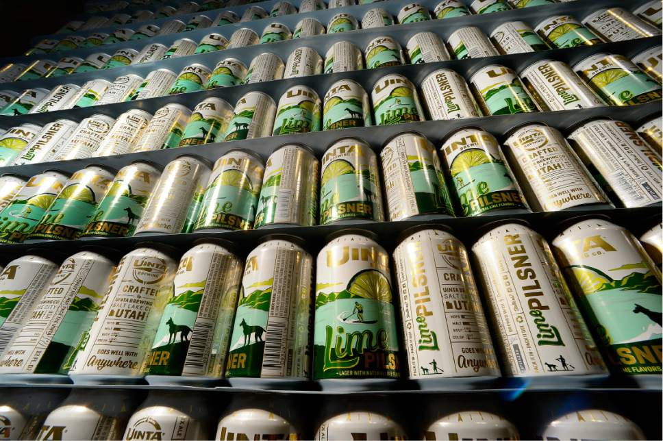 Scott Sommerdorf   |  The Salt Lake Tribune   Empty cans of Uinta Brewing's Lime Pilsner, stand stacked and waiting to be filled, Thursday, July 20, 2017.