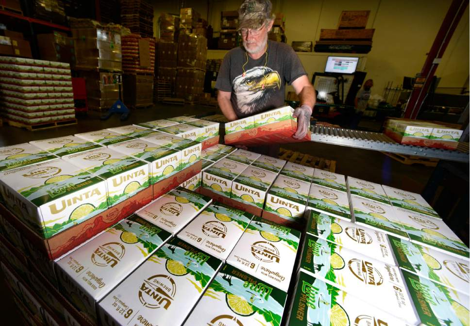 Scott Sommerdorf   |  The Salt Lake Tribune   Packages of Uinta Brewing's Lime Pilsner are stacked into a cube and readied for shipment, Thursday, July 20, 2017. The Pilsner is one of several Uinta beers that are arel 3.2 percent alcohol by weight.