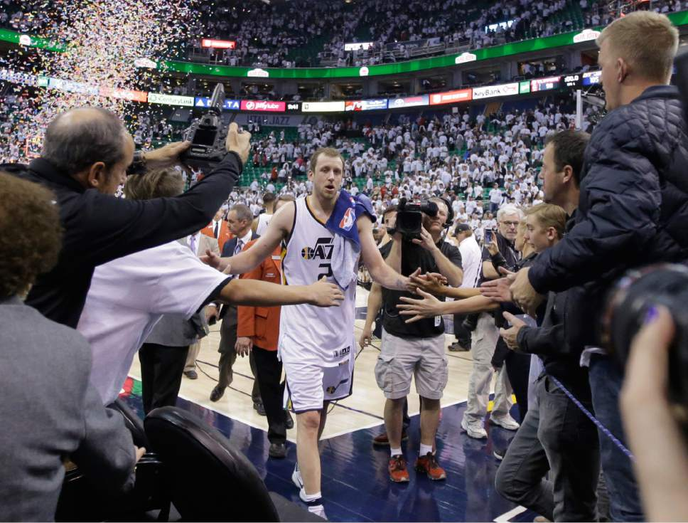 Utah Jazz forward Joe Ingles (2) receives a high-fives from a fans following Game 4 of an NBA basketball first-round playoff series against the Los Angeles Clippers Sunday, April 23, 2017, in Salt Lake City. The Jazz won 105-98. (AP Photo/Rick Bowmer)
