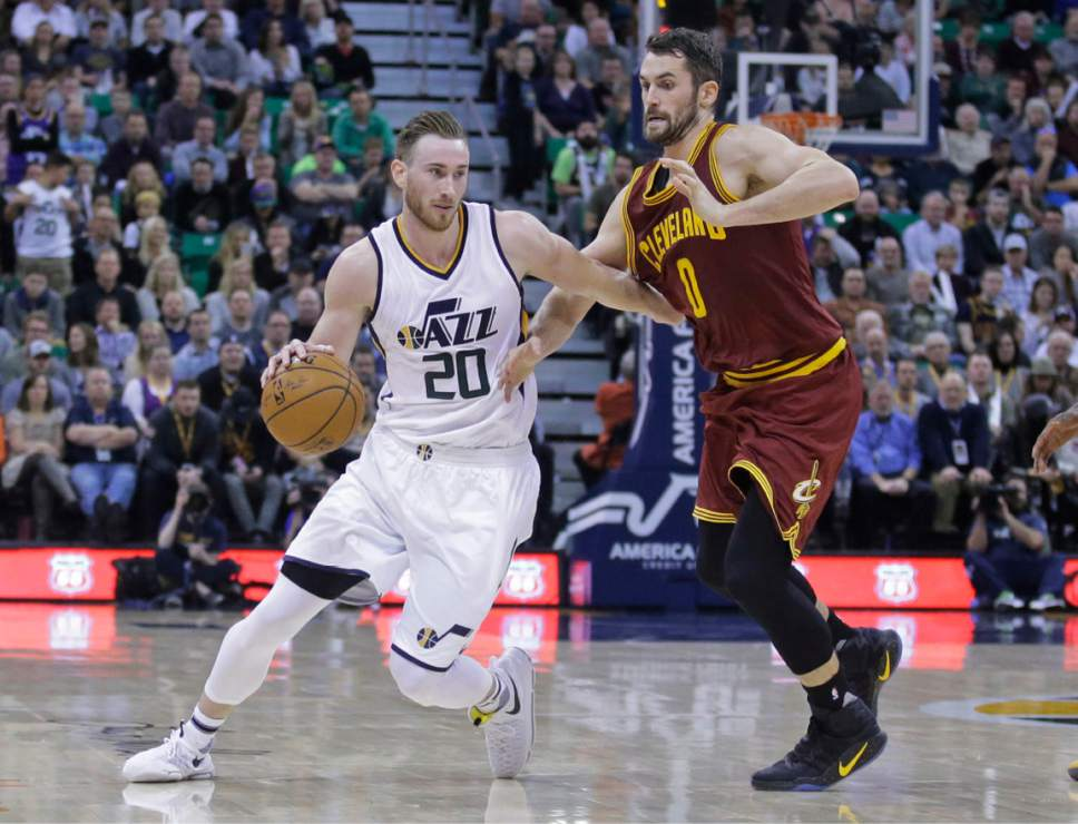 Utah Jazz forward Gordon Hayward (20) drives around Cleveland Cavaliers forward Kevin Love (0) during the second half of an NBA basketball game Tuesday, Jan. 10, 2017, in Salt Lake City. The Jazz won 100-92. (AP Photo/Rick Bowmer)
