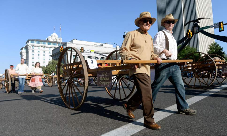 Al Hartmann  |  The Salt Lake Tribune  Handcart pioneers are among the first off the starting line to start the The Day's of '47 parade in downtown Salt Lake City last year celebrating Utah's pioneer heritage and spirit.