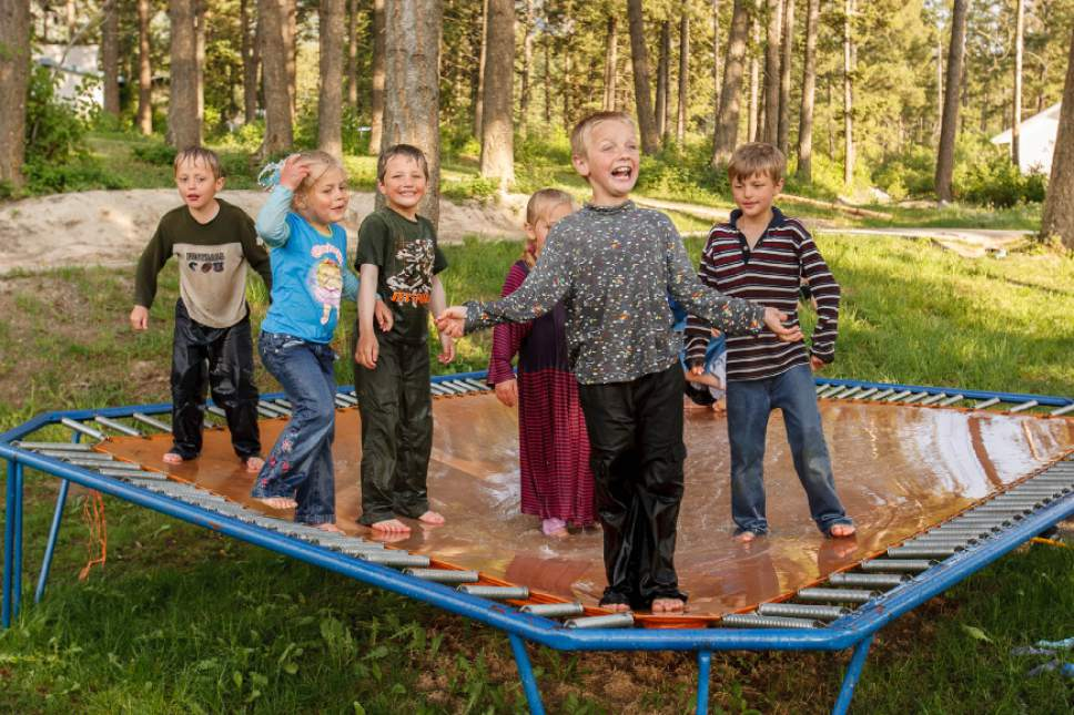 Trent Nelson  |  The Salt Lake Tribune Children of polygamist Winston Blackmore combine water and a trampoline for an afternoon activity in Bountiful British Columbia, 2006.