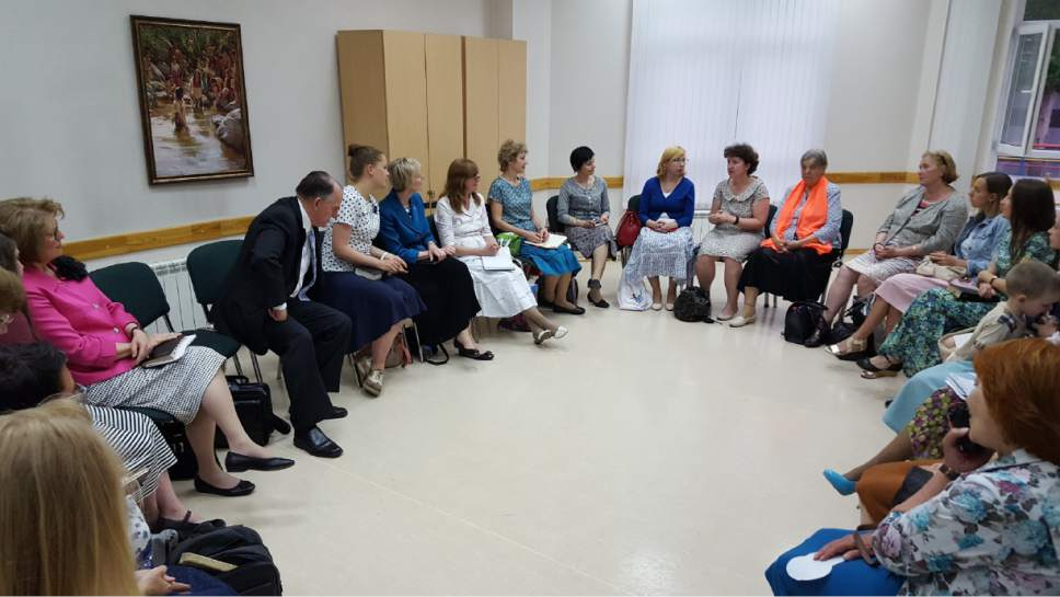 photo courtesy LDS church General Relief Society President Jean B. Bingham visits with church members in Russia.