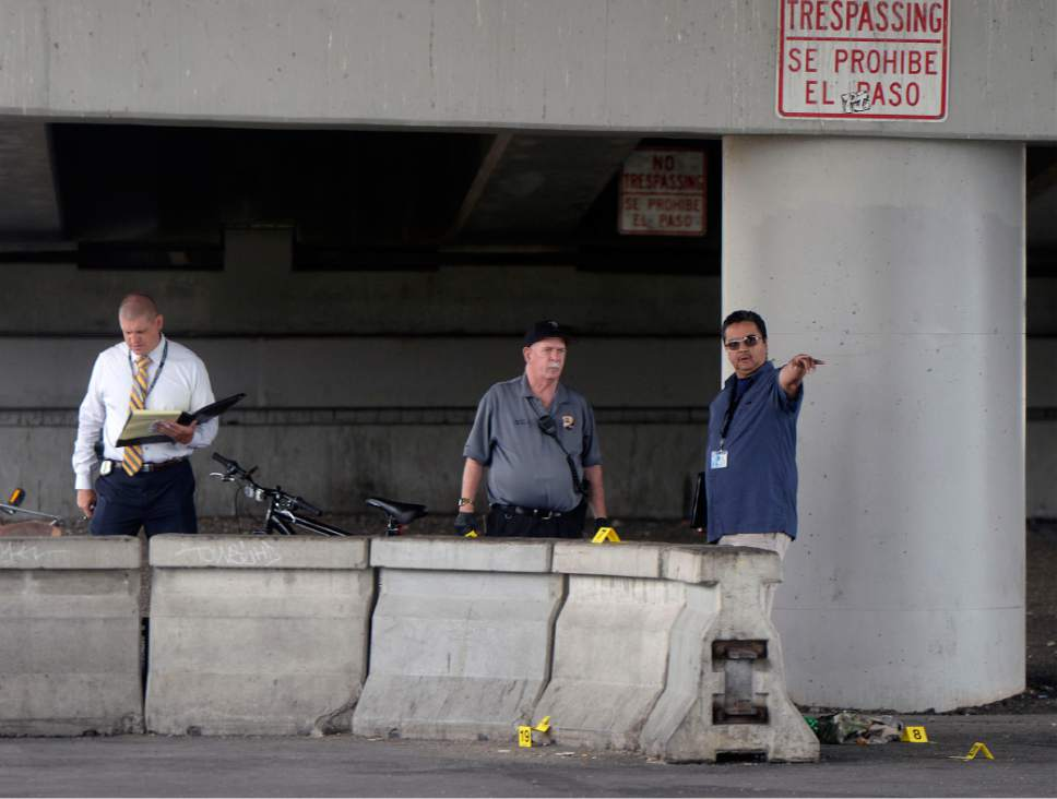 Al Hartmann  |  The Salt Lake Tribune Salt Lake City police investigate homicide-assault crime scene near 500 S. 500 W. Tuesday July 25.