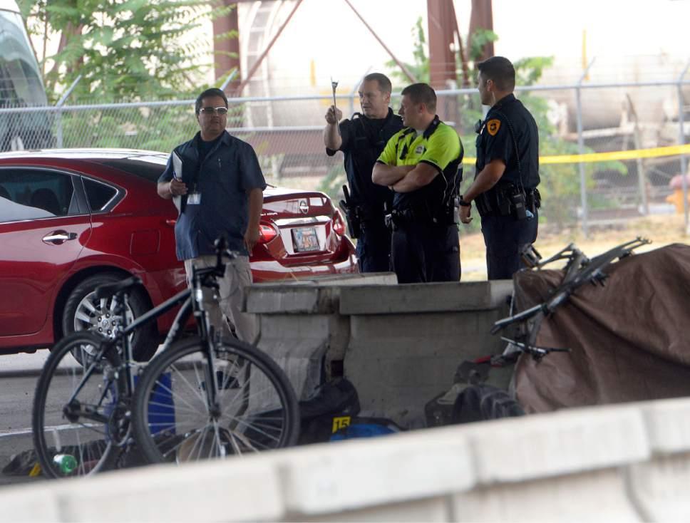 Al Hartmann  |  The Salt Lake Tribune Salt Lake City police investigate homicide-assault crime scene near 500 S. 500 W. on Tuesday.