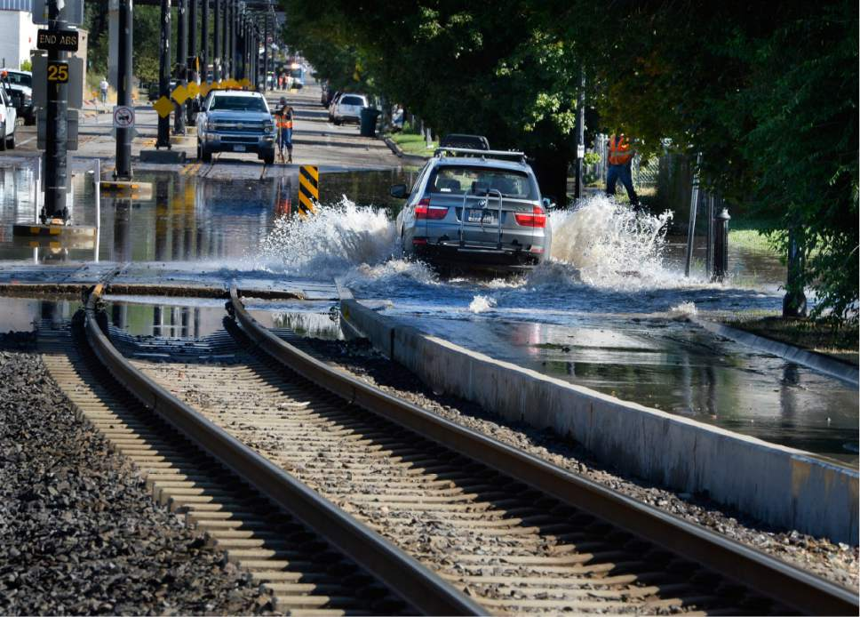 Scott Sommerdorf   |  The Salt Lake Tribune   A determined motorist plowed through northbound 200W next to the flooded TRAX line. Northbound Main Line TRAX trains were prevented from leaving the Ballpark TRAX station due to flooding, Wednesday, July 26, 2017.
