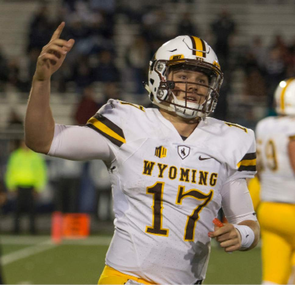 FILE - In this Oct. 22, 2016, file photo, Wyoming quarterback Josh Allen reacts after scoring a touchdown in the second half of an NCAA college football game against Nevada, in Reno, Nev. The incoming junior led the Mountain West in touchdown passes (28) and passing yards per completion (15.33) in his first full year as a Division-I starter.  (AP Photo/Tom R. Smedes, File)