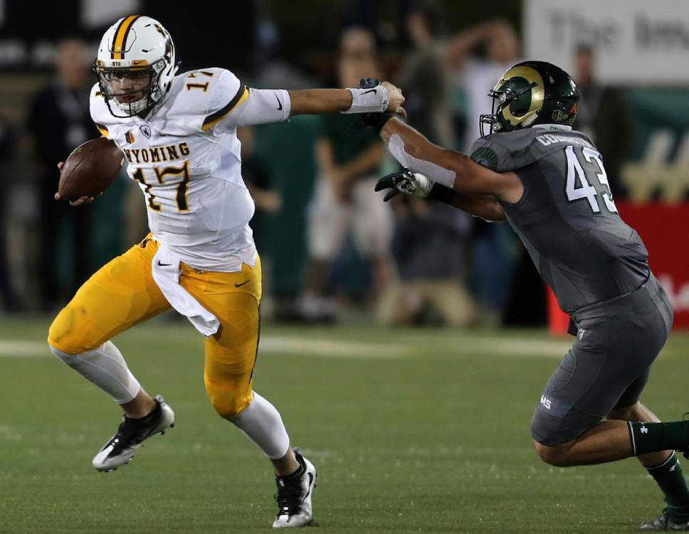 FILE - In this Oct. 1, 2016, file photo, Wyoming quarterback Josh Allen races past Colorado State's Evan Colorito in the first half of an NCAA college football game Saturday, Oct. 1, 2016, in Fort Collins, Colo. In what is being billed as the year of the quarterback, there are several big names emerging from Power 5 conferences. But the best overall talent for next year's NFL draft may be in the Mountain West Conference, Wyoming's Josh Allen. (Blaine McCartney/The Wyoming Tribune Eagle via AP, File)