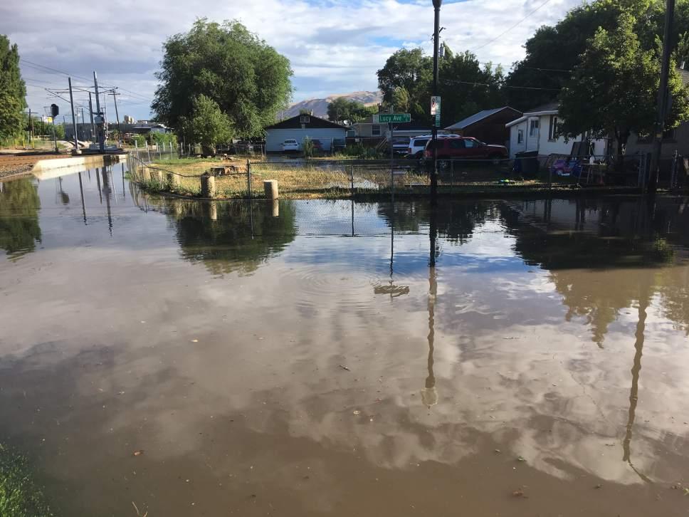 Jeremy Harmon  |  The Salt Lake Tribune Flash flooding in downtown Salt Lake City shut down UTA trains along 1300 South Wednesday morning.