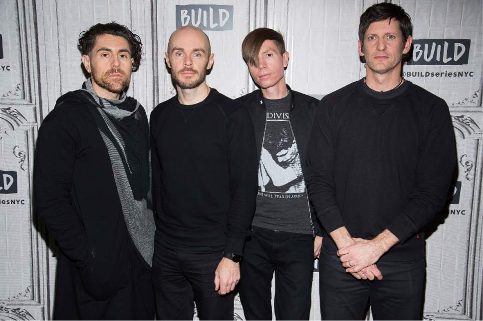 """AFI band members, from left, Davey Havok, Hunter Burgan, Jade Puget and Adam Carson participate in the BUILD Speaker Series to discuss their new record """"The Blood Album"""" at AOL Studios on Thursday, Feb. 2, 2017, in New York. (Photo by Charles Sykes/Invision/AP)"""