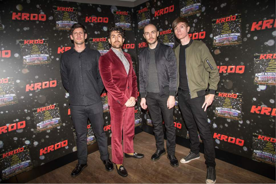 Adam Carson, from left, Davey Havok, Hunter Burgan, and Jade Puget of AFI pose at the 2016 KROQ Almost Acoustic Christmas at The Forum on Saturday, Dec. 10, 2016, in Inglewood, Calif. (Photo by Amy Harris/Invision/AP)