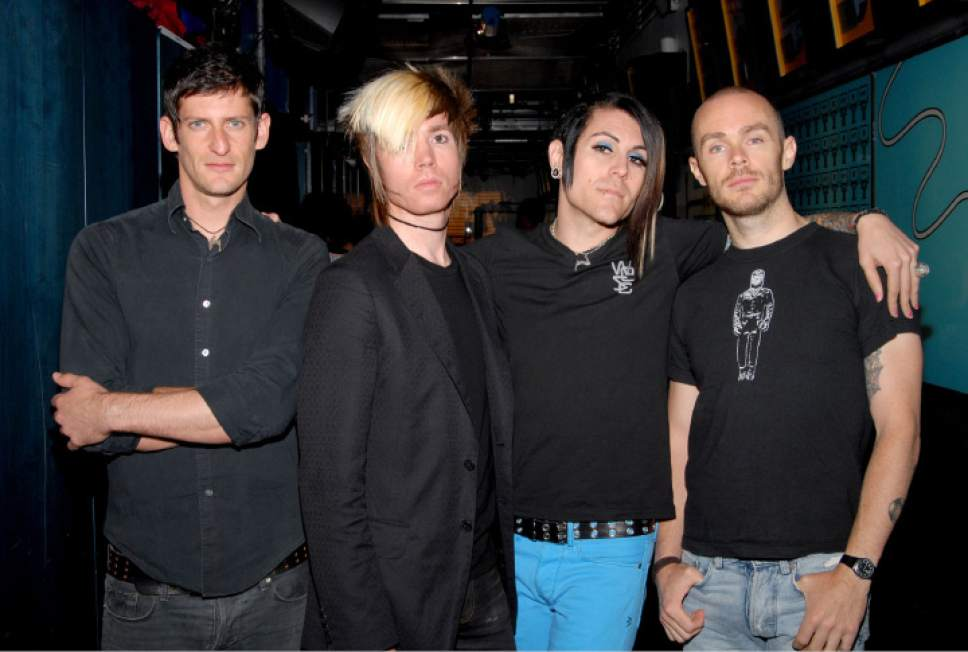 From left, Adam Carson, Jade Puget, Davey Havok and Hunter of the band AFI pose backstage after appearing on MTV's 'Total Request Live' show at MTV Times Square Studios Thursday, Aug. 3, 2006, in New York. (AP Photo/Paul Hawthorne)