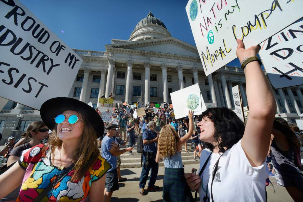 """Scott Sommerdorf      The Salt Lake Tribune   After marching from the Salt Palace to the Utah State Capitol, the """"This Land is Our Land March for Public Lands"""" rallied at the Capitol, Thursday, July 27, 2017."""