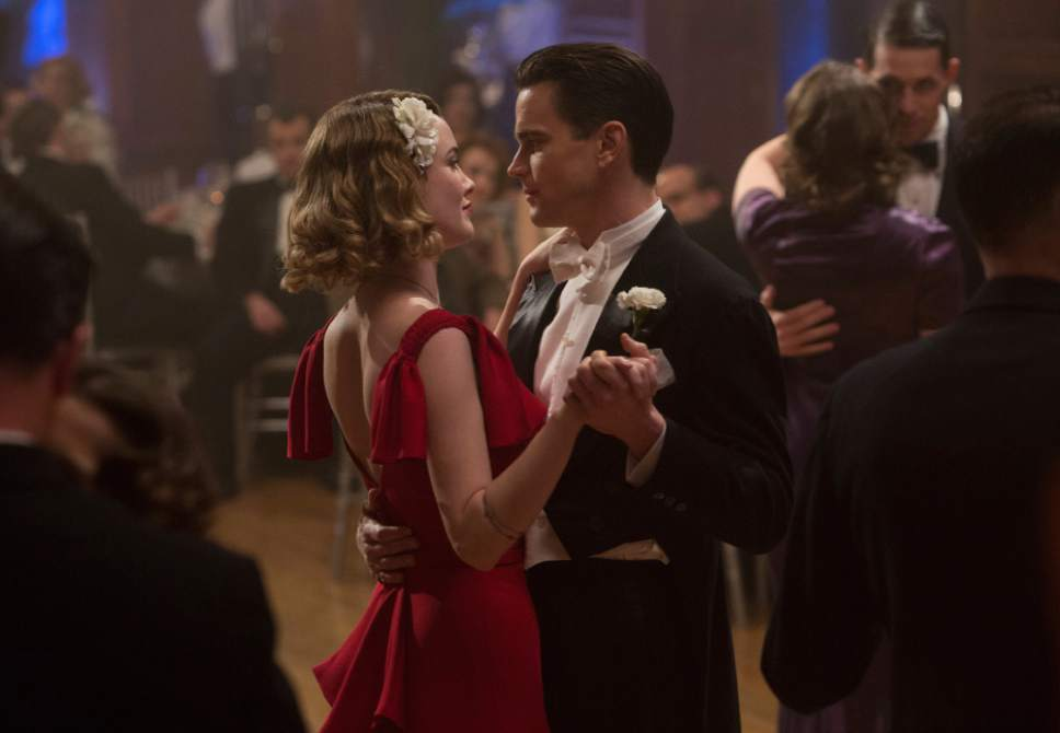 "This image released by Amazon shows Dominique McElligott, left, and Matt Bomer in ""The Last Tycoon."" (Adam Rose/Amazon via AP)"