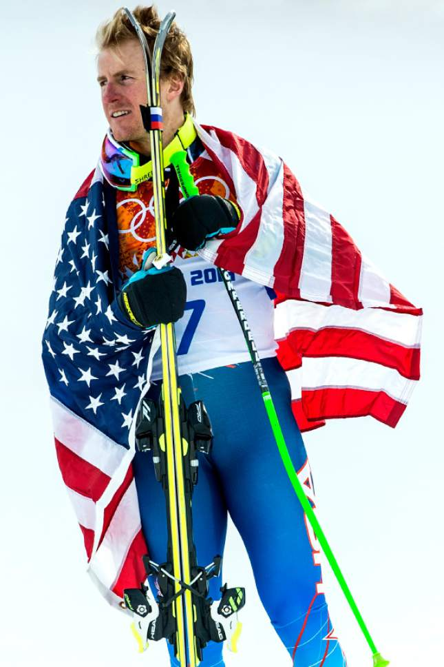 KRASNAYA POLYANA, RUSSIA  - JANUARY 19: Ted Ligety, of Park City, celebrates with an American flag after winning the Men's Giant Slalom at Rosa Khutor Alpine Center during the 2014 Sochi Olympics Wednesday February 19, 2014. LIgety won the gold medal with a cumulative time of 2:45.29. (Photo by Chris Detrick/The Salt Lake Tribune)