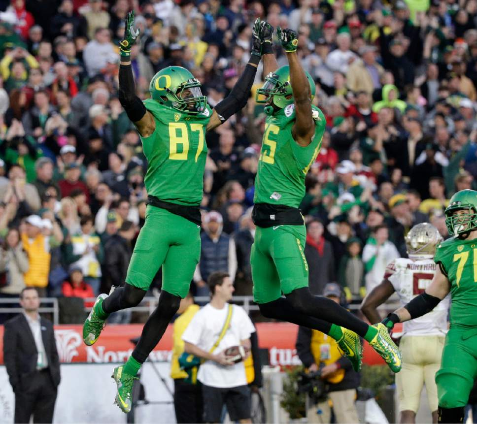 Oregon wide receiver Darren Carrington, left, celebrates his touchdown with tight end Pharaoh Brown during the second half of the Rose Bowl NCAA college football playoff semifinal against Florida State, Thursday, Jan. 1, 2015, in Pasadena, Calif. (AP Photo/Jae C. Hong)