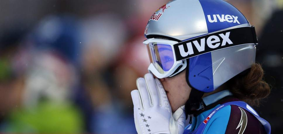 Sarah Hendrickson of the United States awaits the results on a screen after her second jump to win the women's ski jumping HS 106 Individual of the Nordic Ski World Championships in Val di Fiemme, Italy, Friday, Feb. 22, 2013.  (AP Photo/Matthias Schrader)