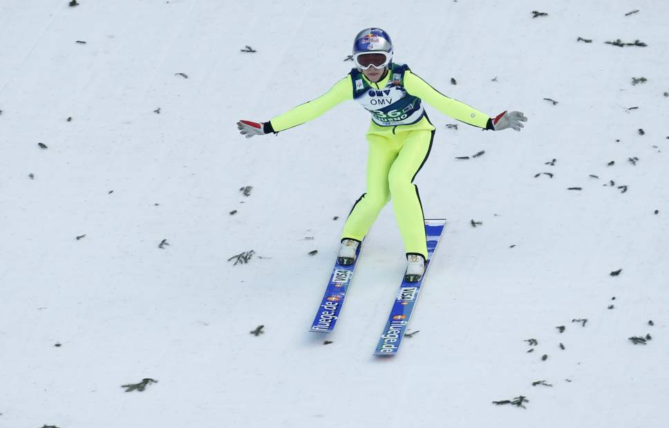 Sarah Hendrickson from the U.S. competes to place third at the Ski Jumping World Cup women's event in Ljubno, Slovenia, Sunday, Feb. 15, 2015. (AP Photo/Darko Bandic)