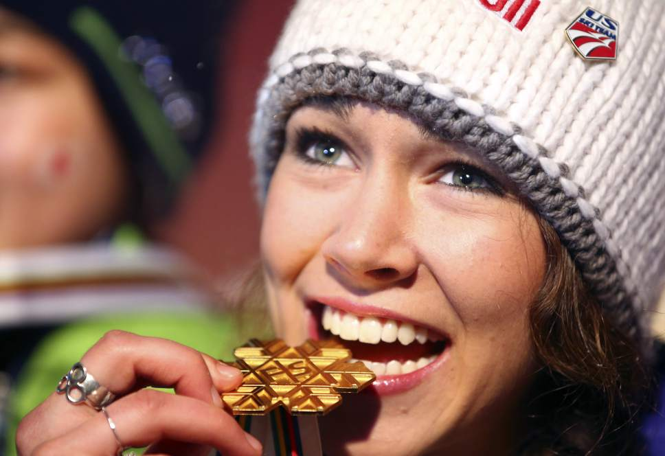 Sarah Hendrickson, of the United States, poses with the gold medal she won in the women's ski jumping, at the Nordic Ski World Championships in Val di Fiemme, Italy, Saturday, Feb. 23, 2013. (AP Photo/Giovanni Auletta)