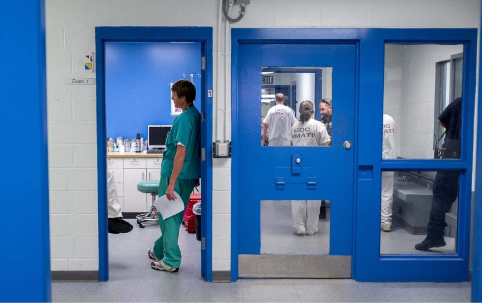 Trent Nelson     The Salt Lake Tribune  Doctor K.C. Tubbs checks on an inmate in an examination room in the infirmary of the Utah State Prison in Draper, Utah Wednesday, August 8, 2012.