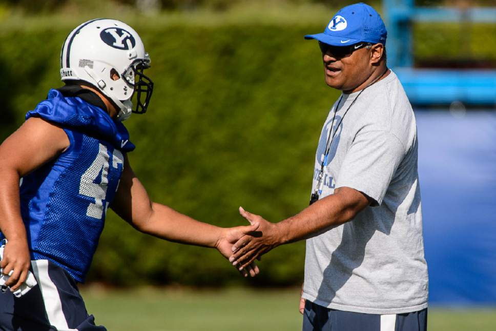Trent Nelson     The Salt Lake Tribune New coach Kalani Sitake oversees his first BYU fall camp practice, Friday August 5, 2016 in Provo.