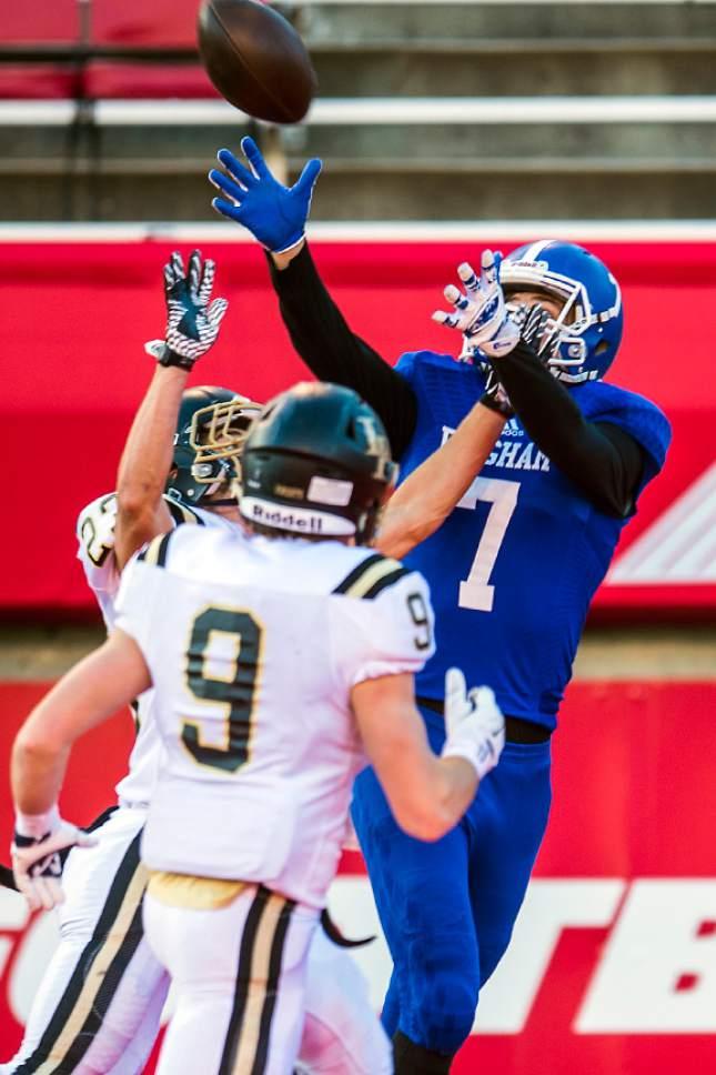Chris Detrick     The Salt Lake Tribune Bingham's Brayden Cosper (7) makes a touchdown catch past Lone Peak's Eli Norman (9) and Lone Peak's Tanner Hansen (23) during the 5A football championship at Rice-Eccles Stadium Friday November 18, 2016.