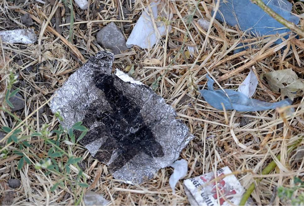 Al Hartmann  |  The Salt Lake Tribune Tinfoil used to inhale burning heroin in the Rio Grande neighborhood Wednesday July 19.