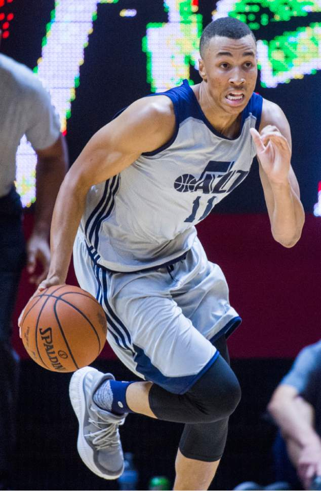 Rick Egan  |  The Salt Lake Tribune  Utah guard Dante Exum (11) leads a Jazz fast break,  in Utah Jazz summer league action, Utah Jazz and the San Antonio Spurs at the Jon M. Huntsman Center, Monday, July 3, 2017.