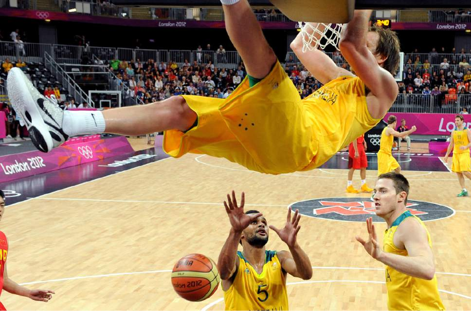 Australia's Joe Ingles, top, dunks to score against China during a men's basketball game at the 2012 Summer Olympics Thursday, Aug. 2, 2012, in London. (AP Photo/Mark Ralston, Pool)