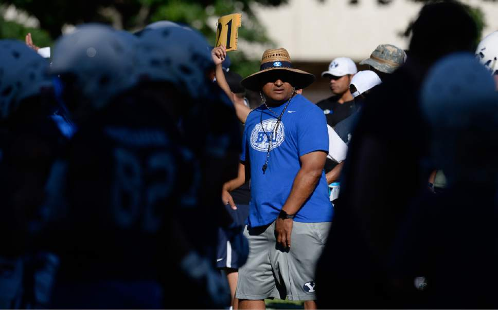 Francisco Kjolseth   The Salt Lake Tribune BYU football coach Kalani Sitake, center, begins preparations for the season with preseason training camp on Thursday, July 27, 2017, at their practice field in Provo.