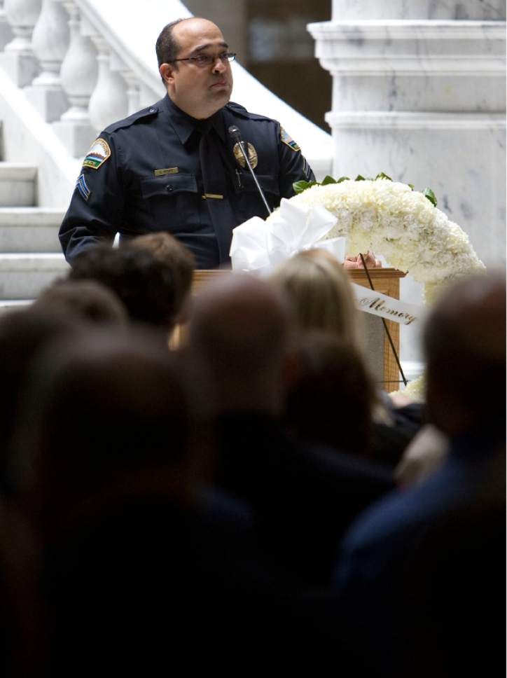 |  Tribune file photo  Aaron D. Rosen, of the Saratoga Springs Police Department, speaks at a 2008 memorial service for fallen police officers. Rosen was arrested on Thursday, July 27, 2017, on suspicion of unlawful sexual activities with a minor.