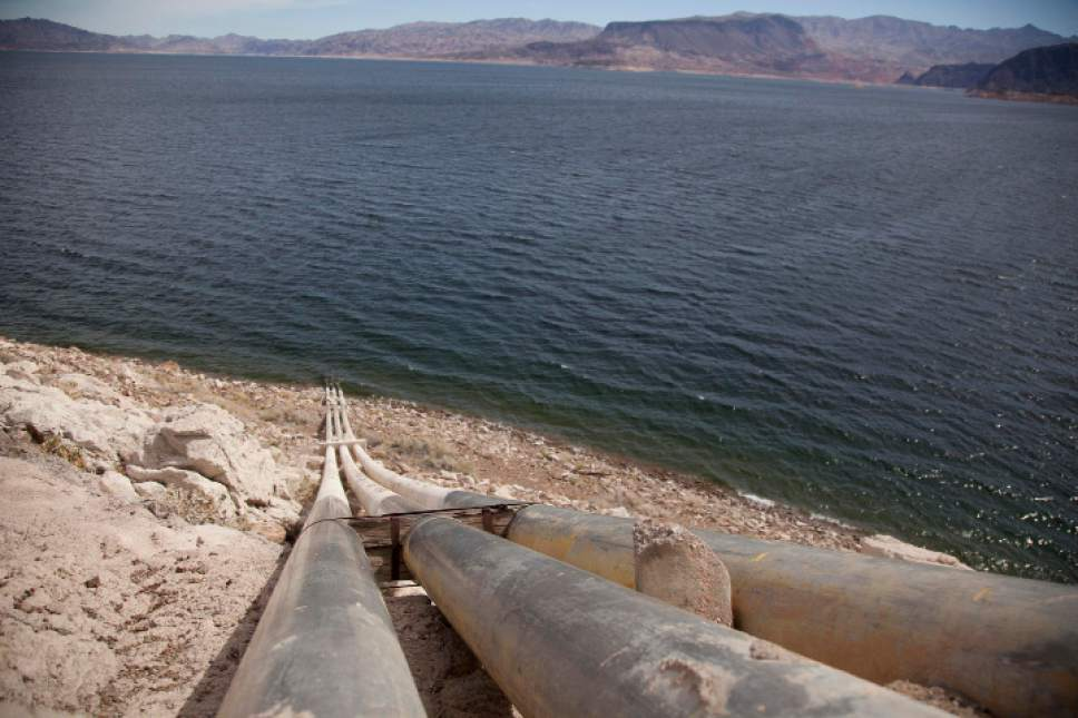 FILE - This March 23, 2012, file photo shows pipes extending into Lake Mead well above the high water mark near Boulder City, Nevada. A years-long fight over a plan to build a 263-mile water pipeline along the Nevada-Utah state line to bring rural groundwater to Las Vegas is about to get a first-ever hearing before a federal judge in Nevada. The pipeline could cost billions of dollars to build, but the Southern Nevada Water Authority says it may become essential if drought keeps shrinking the Lake Mead reservoir on the Colorado River. (AP Photo/Julie Jacobson, File)