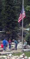 The flag was flown at half-staff but scouting activities continued at Camp Steiner on Wednesday, the day after 15-year-old Boy Scout Paul Ostler was killed and three others injured by a lightning strike.