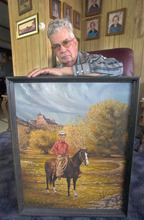 Waldo Wilcox with a 1976 painting of himself in the Range Creek area of the Book Cliffs near Green River. Photo was taken inside his Green River home July 29, 2004. Wilcox and his family protected 1000s of Fremont Indian sites for more than 50 years. Griffin/photo