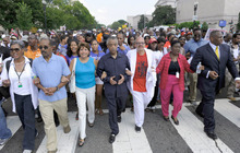Rev. Al Sharpton, center, and others march through Washington, Saturday, Aug. 28, 2010, to the site of the Martin Luther King Jr. Memorial that is under construction on the 47th anniversary of Martin Luther King Jr.'s