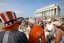 James Johnson of Delray Beach, Fla., left, and Jim Davis of Provo, Utah, attend the