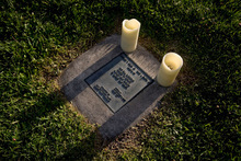 Jeremy Harmon  |  The Salt Lake Tribune  Candles sit on a marker memorializing Ted Fields, Jr. and David Martin III during commemorative march at Liberty Park on Saturday. The event, held on the anniversary of Dr. Martin Luther King, Jr.'s