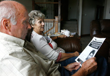 Rick Egan      The Salt Lake Tribune  Ted and Rita Holtry look at a flier given to them by the police as authorities searched the buildings on their property east of Kanab on Sunday.