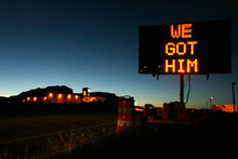 Rick Egan | The Salt Lake Tribune A sign on Highway 89, east of Kanab reflects Scott Curley's capture early Monday morning.
